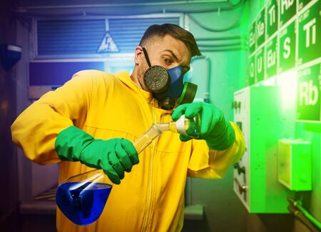 protective suit: Man in protective suit working with tubes while cooking meth