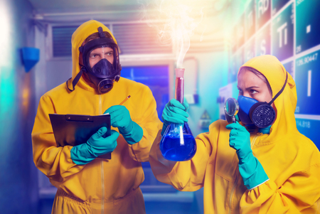 Man and woman in protective suits cooking methamphetamine in the lab
