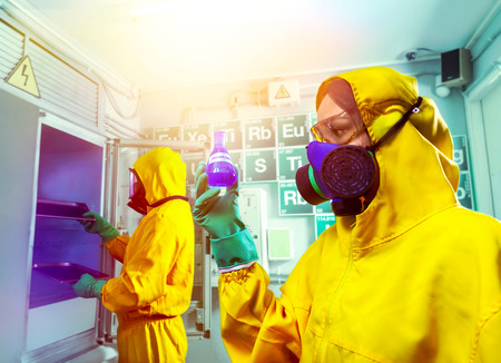 meth: Man and woman in protective suits cooking meth in the lab