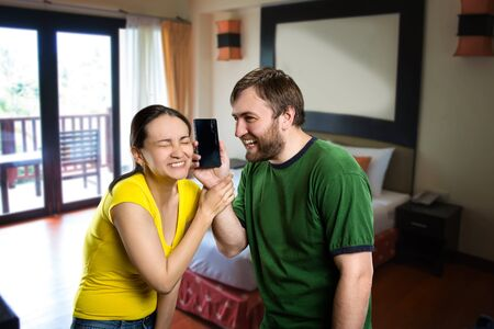 anecdote: Young couple having fun with a phone Stock Photo