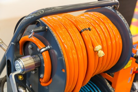 Close up view of orange garden hose Stock Photo