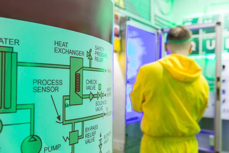 protective suit: Man in protective suit working in the lab Stock Photo