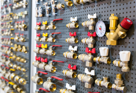plumbing accessories: Different valves and other plumbing equipment on the wall