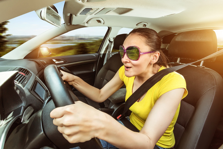speed car: Woman is practicing driving the car