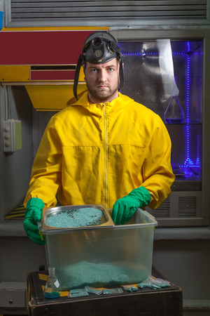 protective suit: Man in protective suit cooking meth in the lab