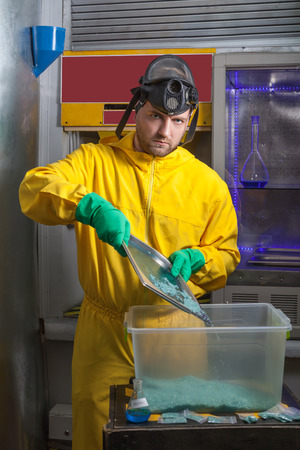 meth: Man in protective suit cooking meth in the lab