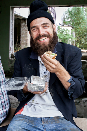 Happy homeless with food outdoor Stock Photo