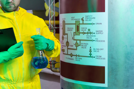 methamphetamine: Man in protective suit working in the lab Stock Photo