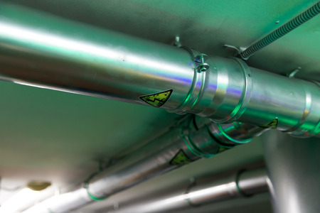 Metal pipe on the ceiling close up