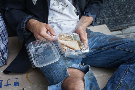 vagrant: Desperate vagrant with his meal Stock Photo