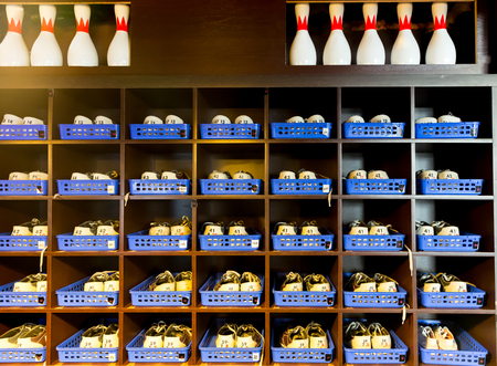 pairs: Many pairs of bowling shoes on the shelf Stock Photo