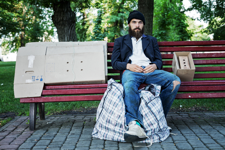 vagrant: Vagrant is sitting on the bench Stock Photo