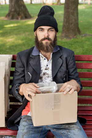 vagrant: Vagrant with box is sitting on the bench