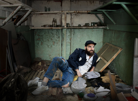 dirty room: Vagrant lying in a dirty room