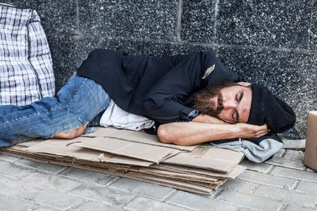 Homeless is sleeping on the cardboard on the street Stock Photo