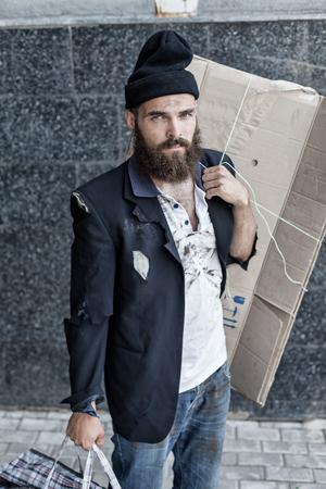 joblessness: Sad vagrant is walking on the street Stock Photo