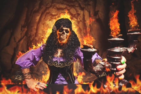 demoniacal: Sorceress is burning away, she has skull instead of her face Stock Photo