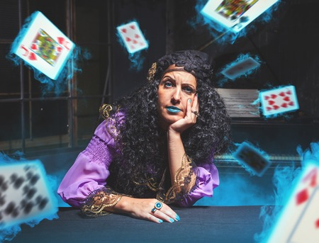witchcraft: Sorceress practising witchcraft, cards are flying in her room