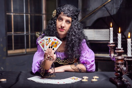 fortunetelling: Close up of sorceress telling fortunes using cards