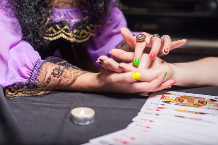 psychic reading: Close up of sorceress reading somebodys hand