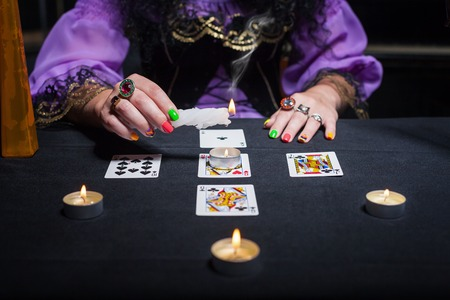 telepathy: Sorceress telling fortunes using cards and candles