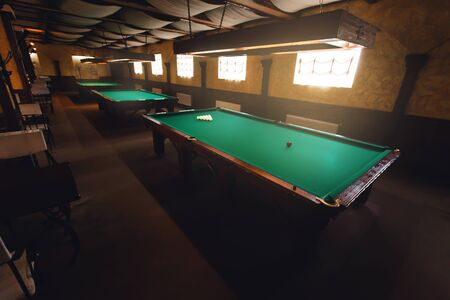 snooker halls: Top side view of modern billiard saloon with table ready for play