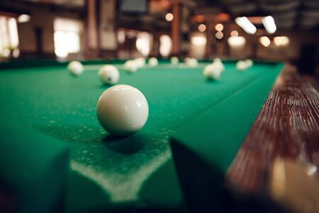 One white billiard ball near the pocket focused