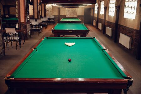 recreate: Modern billiard saloon with table prepared for play