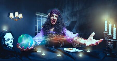 satanism: Angry sorceress working with crystal ball