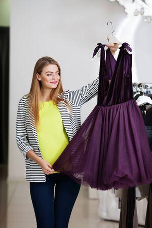 summer dress: Woman holding a beautiful summer dress