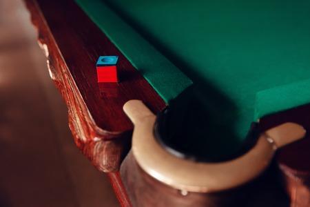 snooker halls: Close up of billiard pocket and chalk