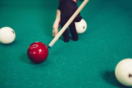 snooker halls: Close up of man preparing to shoot playing billiard Stock Photo