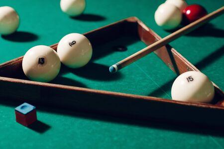 billiard: Billiard items on the table: balls, chalk, stick and triangle Stock Photo
