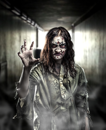 Horror zombie in a dark corridor. Halloween.