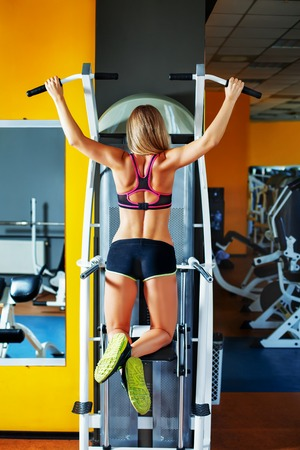 strong chin: Young girl chining up in the gym Stock Photo