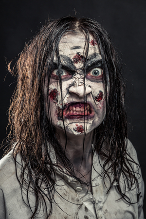Portrait of the horror zombie woman with bloody face Stock Photo