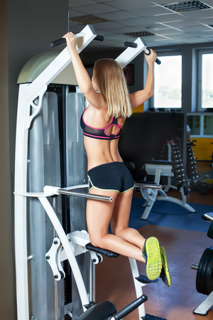 Young girl chining up in the gym Stock Photo