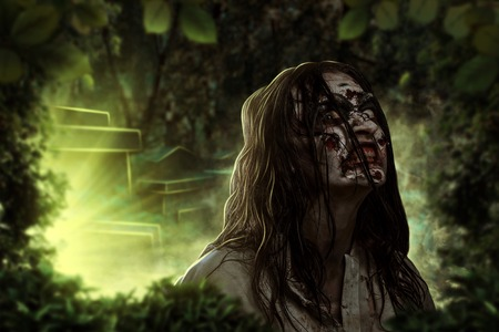The shouting female zombie against the background of the cemetery. Horror