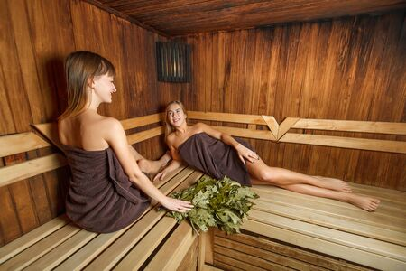 spa therapy: Beautiful laughing girls relax after spa therapy. Stock Photo