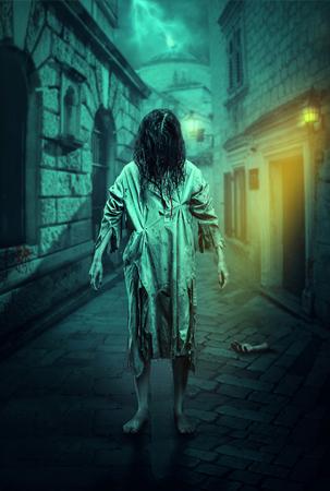 Horror zombie on the dark street. Halloween.