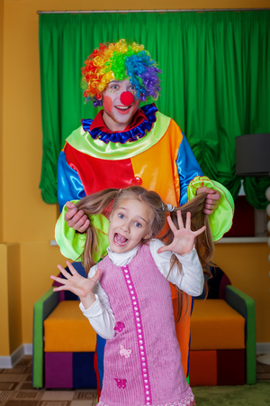 surprise party: Surprise on birthday party, parents have invited the clown. Baby birthday celebration concept.