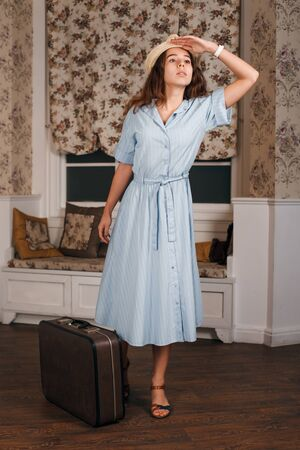 get ready: Young woman get ready on a journey. Retro style suitable for travel concept. Stock Photo