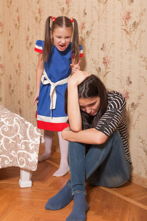 scold: Angry little girl scold her  mother. Stock Photo