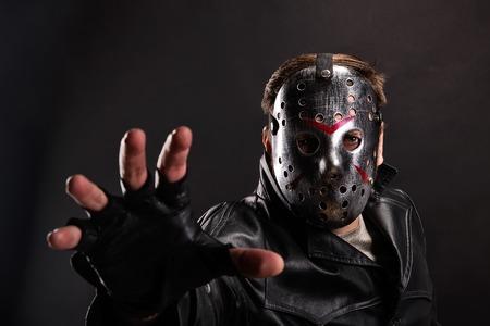 Maniac in hockey mask on dark background Stock Photo