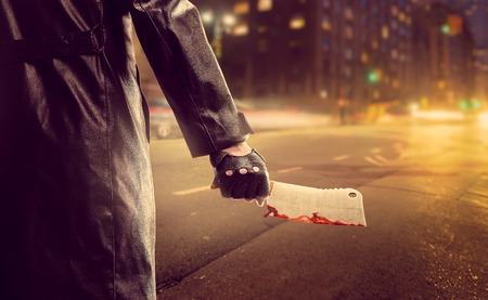 cleaver: Serial murderer with bloody meat cleaver on road