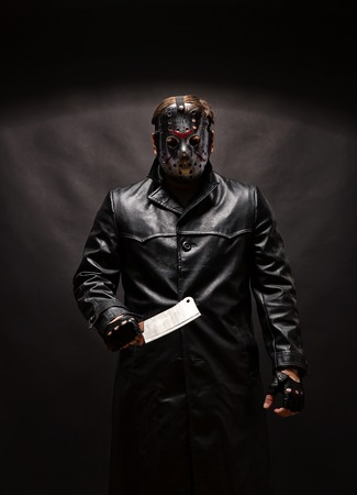 vindictive: Bloody murderer in hockey mask with meat cleaver