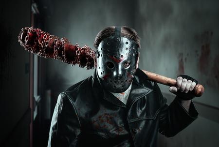 Serial murderer holding bloody baseball-bat
