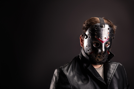 vindictive: Bloody murderer in hockey mask portrait Stock Photo