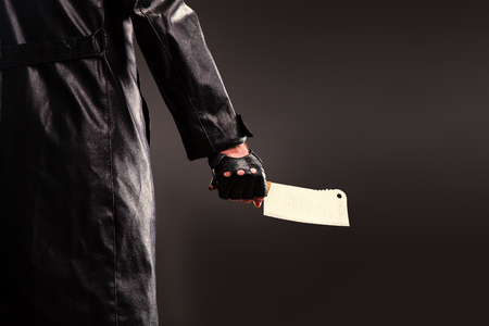 Killer holding meat cleaver in hand. Stock Photo