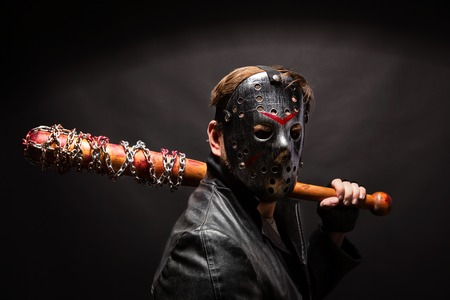 vindictive: Bloody maniac in mask and black leather coat